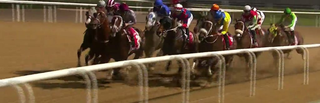 California Chrome draws into contention while racing three-wide.