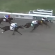 Gun Runner (inside)  holds off Forevamo (middle) and Mo Tom (outside) in the Risen Star Stakes.