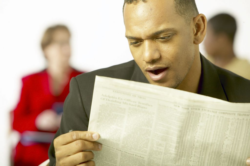 Man studying the racing results.