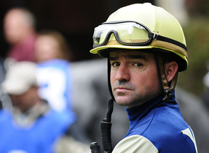 Jockey Kent Desormeaux guided brother Keith's Exaggerator to victory in the Santa Anita Derby.