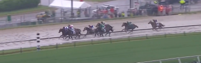 The horses round the final turn in the 2016 Preakness Stakes.