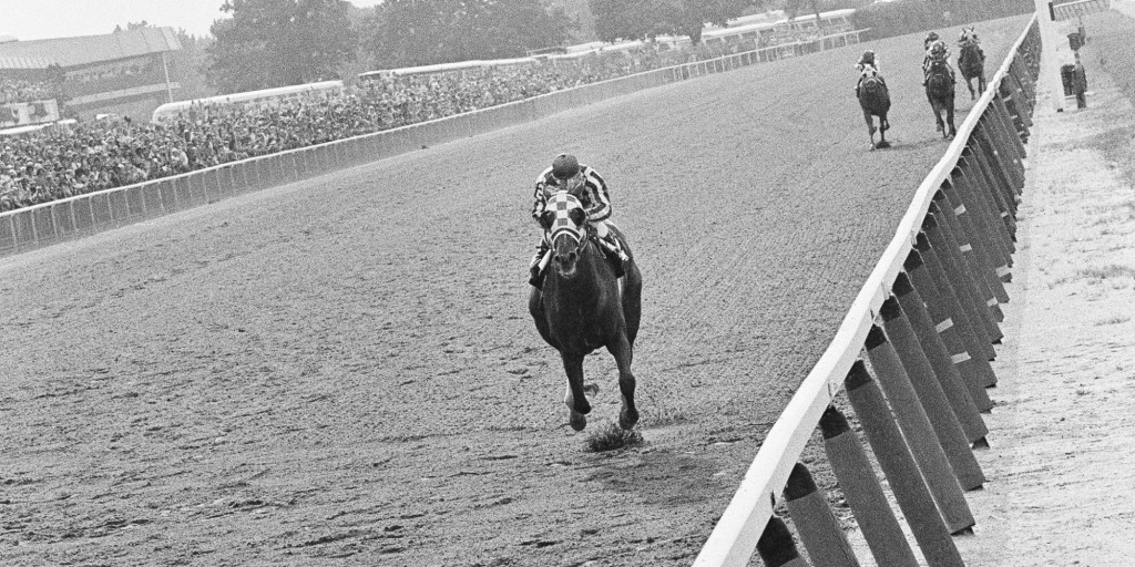 Secretariat, with jockey Ron Turcotte up, powers his way to victory in the Belmont Stakes at Belmont Park on June 9, 1973 to become the first horse since Citation in 1948 to win the Triple Crown (AP photo).