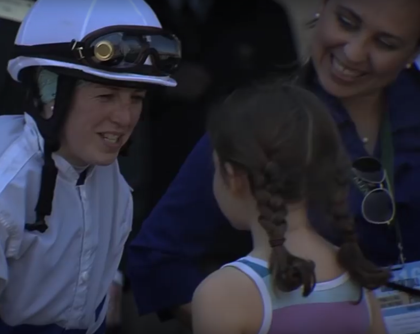 Jockey Sophie Doyle chats with a young fan.
