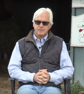 Bob Baffert sends out Improbable in the Preakness Stakes.
