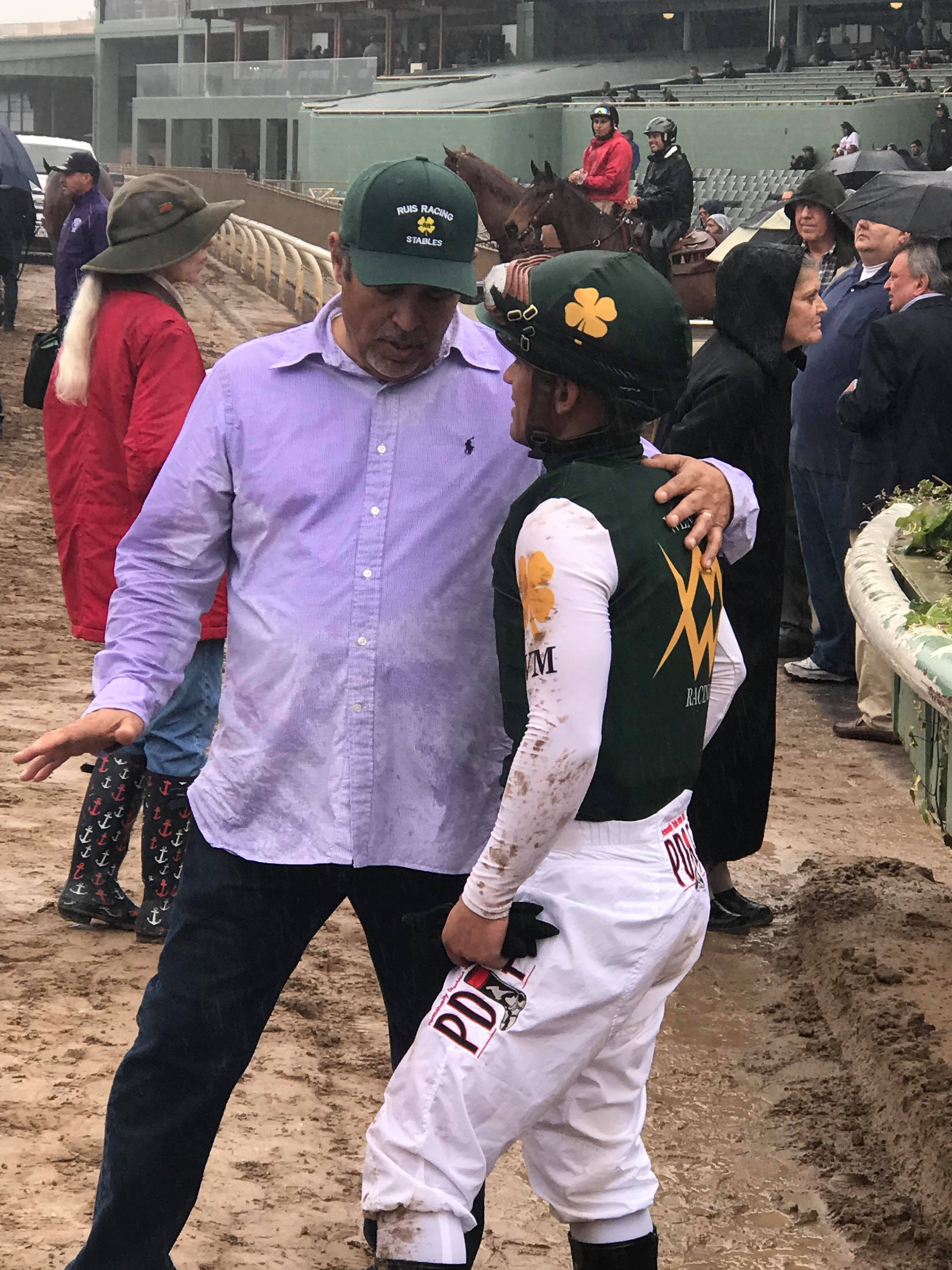 Trainer Mick Ruis and jockey Javier Castellano discuss the disqualification of rival McKinzie (photo by Margaret Ransom).