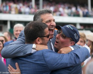 The connections on Monomy Girl celebrate after a hard-fought victory in the Kentucky Oaks on Friday (photo by Jordan Thomson).