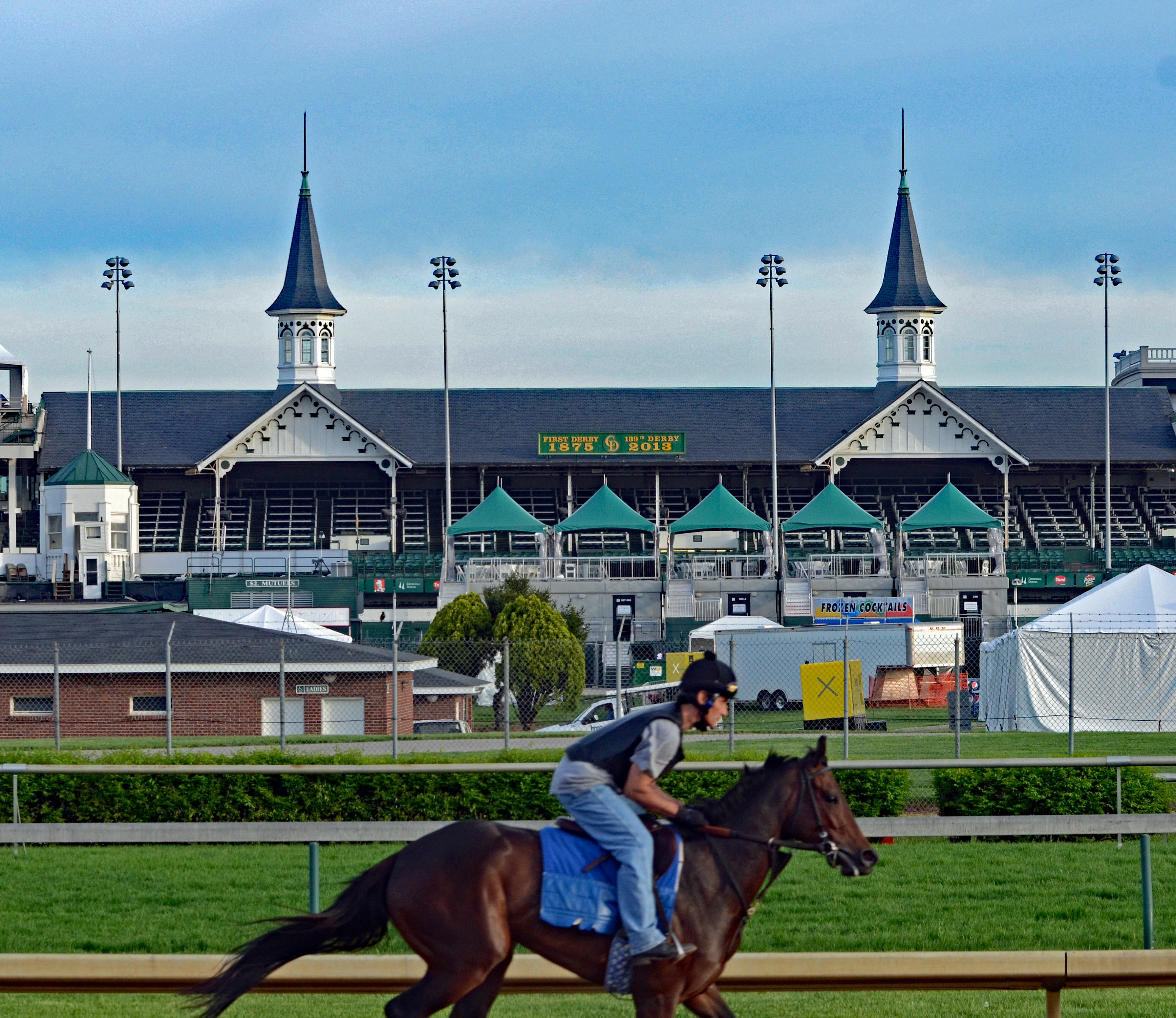Horse galloping past the Twin Spires of Churchill Downs (photo by Tom Ferry).