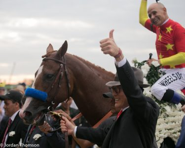Justify in the winner's circle after becoming the 13th Triple Crown winner (photo by Jordan Thomson).