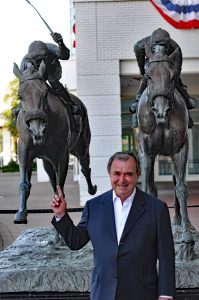 John Henry's trainer Ronald McAnally in front of the Against All Odds statue at Arlington Park (photo by Tom Ferry).