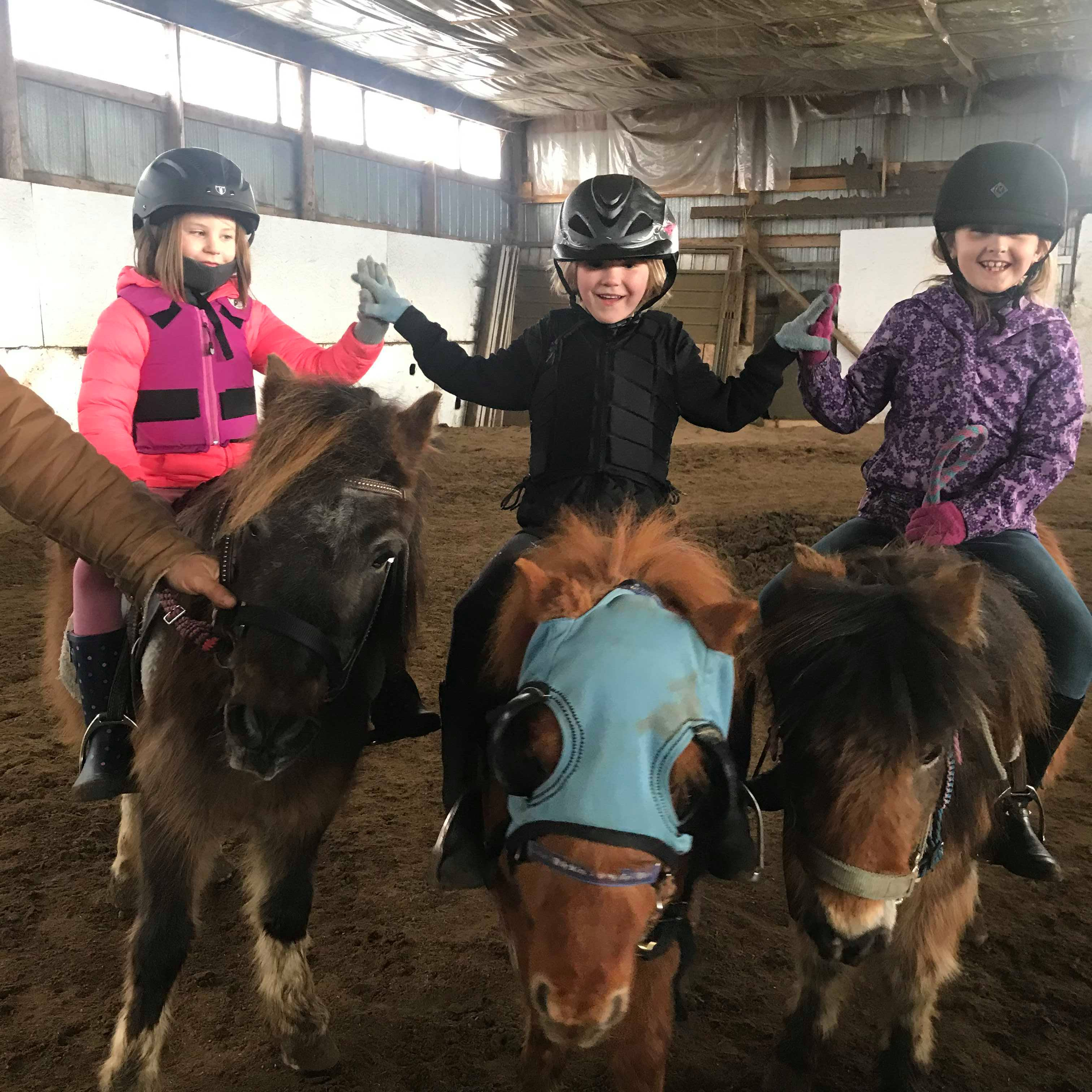 The smiles say it all for the kids in the Junior Jockeys of Flying Cross Ranch program (photo courtesy of Ray Sturgeon).