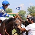 Jockey Miguel Mena and trainer Dale Romans celebrate after Dennis' Moment breaks his maiden by 19 1/4 lengths